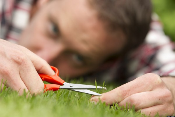 Obsessive man laying on grass, perfection