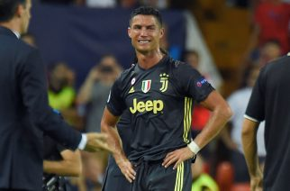 Juventus' Portuguese forward Cristiano Ronaldo (C) cries after receiving a red card during the UEFA Champions League group H football match between Valencia CF and Juventus FC at the Mestalla stadium in Valencia on September 19, 2018. (Photo by JOSE JORDAN / AFP)        (Photo credit should read JOSE JORDAN/AFP/Getty Images)